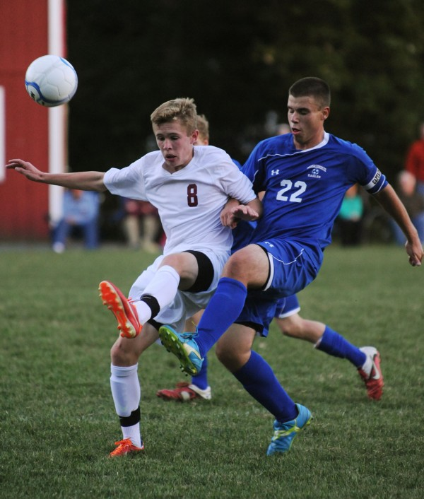 Bangor's Carson Atherley and Messalonskee's Ryan Erskine battle for control of the ball during second-half action at Bangor on Monday. Bangor won 3-2 in overtime.