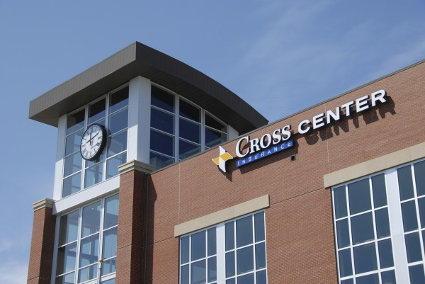 The Cross Insurance Center sign adorns the wall next to the Clock Tower of the new $65 million entertainment complex.