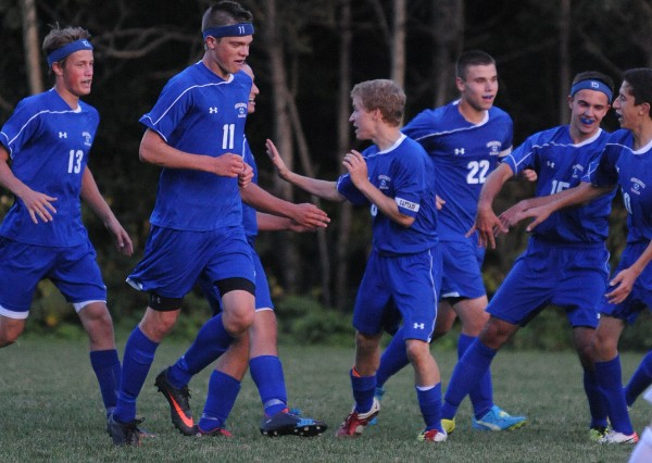 Messalonskee boys soccer players celebrate their second goal against Bangor during second-half action at Bangor on Monday. Bangor went on to win in overtime 3-2.