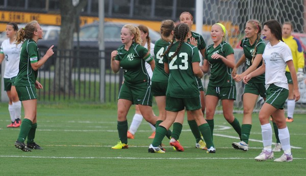 The MDI girls soccer team celebrates it's first goal against Old Town during second half action at Husson University in Bangor on Tuesday. MDI went on to  win 2-0.