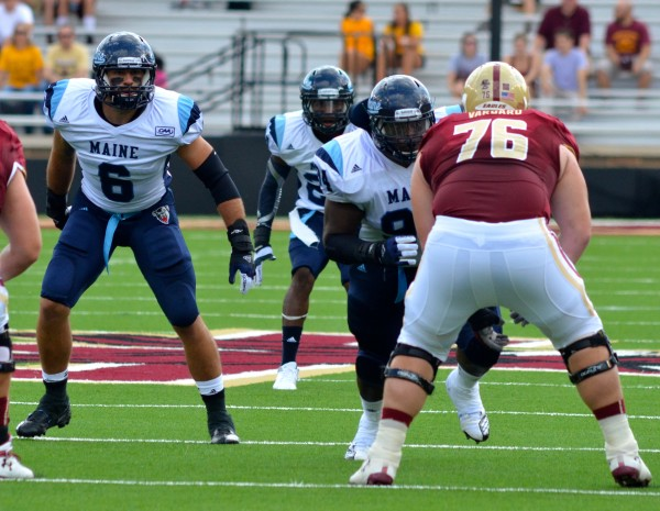 Troy Eastman (left) of the University of Maine football team waits to make a play during a 2012 game at Boston College. The senior linebacker is an integral part of the Black Bears' defense.