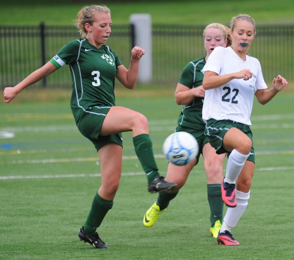 MDI's Riley Heist and Old Town's Rachel Martin vie for control of the ball, edging out MDI's Shelby O'Neil during second half action at Husson University in Bangor on Tuesday. MDI went on to win 2-0.