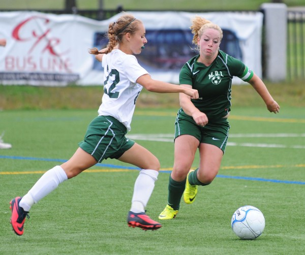 Old Town's Rachel Martin and MDI's Shelby O'Neil vie for control of the ball, during second half action at Husson University in Bangor on Tuesday. MDI went on to win 2-0.