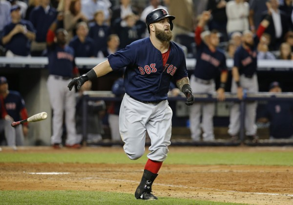 Boston Red Sox batter Mike Napoli tosses his bat and watches the ball as he hits a grand-slam against the New York Yankees in the seventh inning  at Yankee Stadium in New York Friday night.