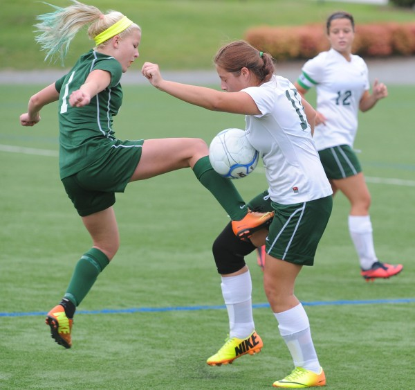 MDI's Julia Mace and Old Town's Misty Belanger vie for control of the ball during second half action at Husson University in Bangor on Tuesday. MDI went on to win 2-0.