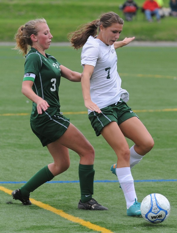 -MDI's Riley Heist and Old Town's Brittany Cousins vie for control of the ball during second half action at Husson University in Bangor on Tuesday. MDI went on to win 2-0.