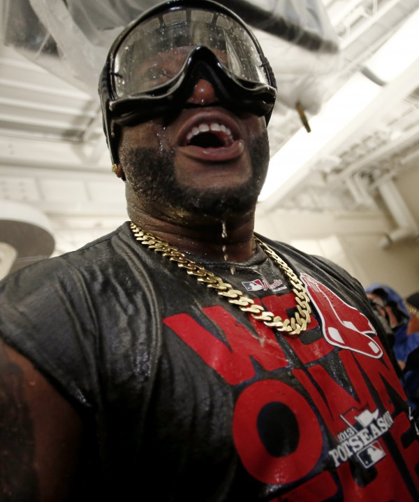 Boston's David Ortiz leads the celebration after the Red Sox won the AL East with a win over the Toronto Blue Jays at Fenway Park Friday night.
