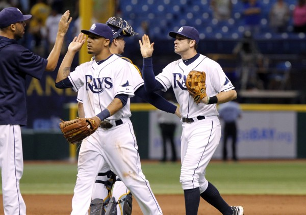Tampa Bay's Desmond Jennings (8) and third baseman Evan Longoria (3) high five teammates after they beat the Boston Red Sox at Tropicana Field Thursday night 4-3.