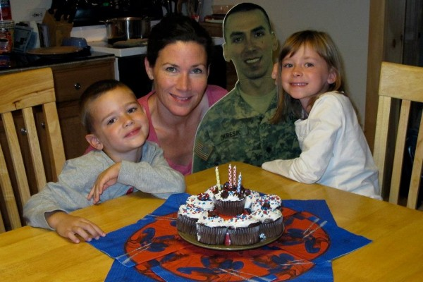The &quotflat daddy&quot of Staff Sgt. Daryl O'Kresik, who is also a Bangor firefighter and paramedic, &quotattends&quot the fourth birthday of his son, Evan, in October 2012 while he was deployed to Afghanistan with the 488th Military Police Company. Also pictured are his wife, Linda Coan O'Kresik, and their daughter, Ava.