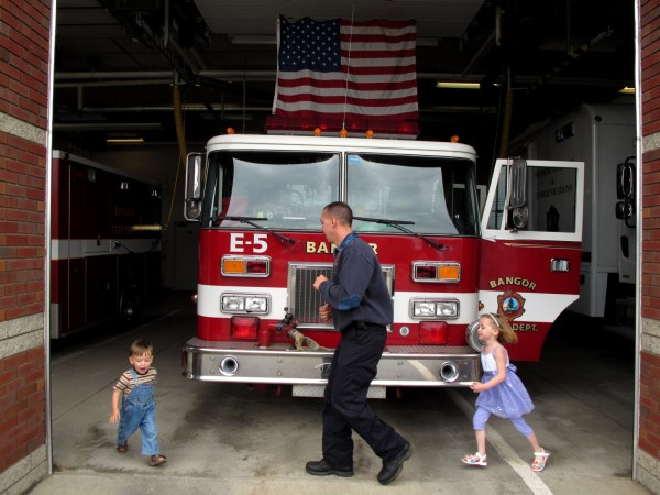 Bangor firefighter/paramedic Daryl O'Kresik plays with his kids Evan and Ava, who love to stop in and see their dad at work, on June 12, 2010.