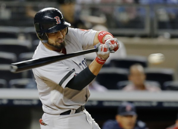 Boston's Shane Victorino hits a single to drive in the go-ahead run against the New York Yankees in the 10th inning at Yankee Stadium in New York Thursday night.