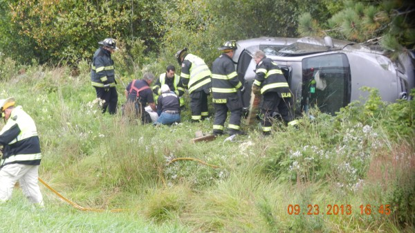 A Carmel woman was injured late Monday afternoon after she lost control of her silver sedan while trying to avoid a collision with a green car that cut into her path on Interstate 95.