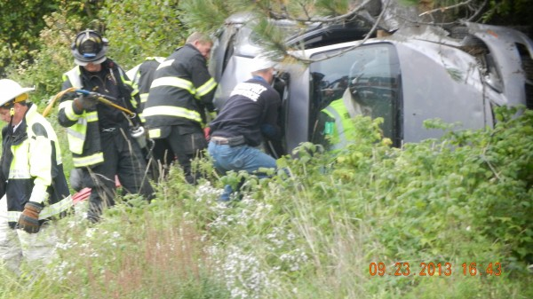 Bangor firefighters at the scene of an accident after A Carmelwoman was injured Monday afternoon after swerving to avoid a collision with a vehicle on Interstate 95.
