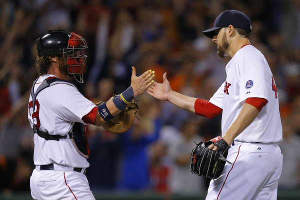 Boston Red Sox catcher Jarrod Saltalamacchia and pitcher John Lackey congratulate each other after the Red Sox beat the Baltimore Orioles 3-1 at Fenway Park in Boston Thursday night.