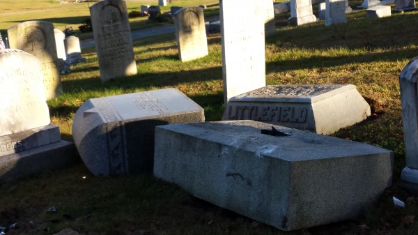 The Littlefield family stone was broken off its base during a demolition derby-style fight between a mother and daughter from Winthrop at the Monmouth Ridge Cemetery on Friday night, according to authorities.