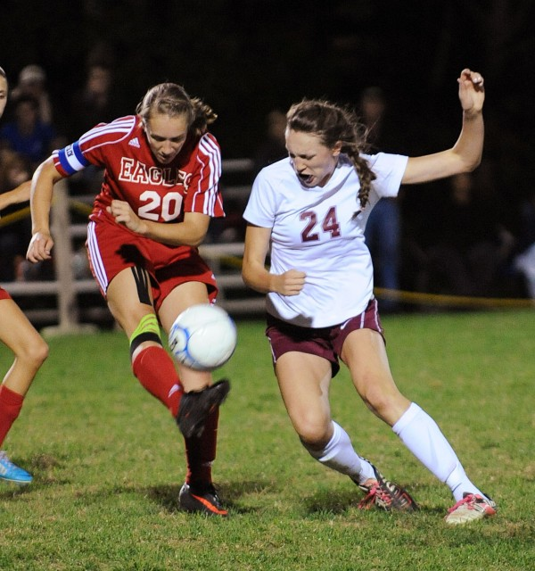 Bangor's Mary Butler (right) and Mount Ararat's Danielle Krause battle for control of the ball during first-half action at Bangor on Friday.