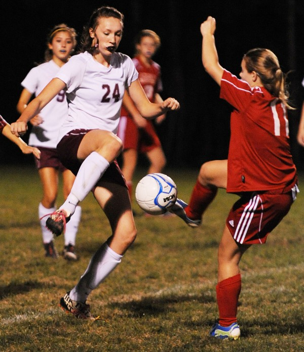 Bangor's Mary Butler and  Mount Ararat's Katie Labbay converge on the ball during first-half action at Bangor on Friday.