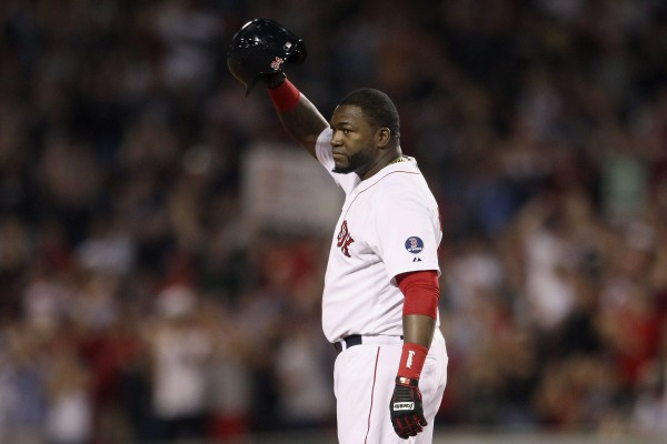 David Ortiz of the Boston Red Sox acknowledges the crowd after recording his 2,00th career hit during Wednesday's game at Fenway Park in Boston. The Red Sox pounded the Tigers 20-4.