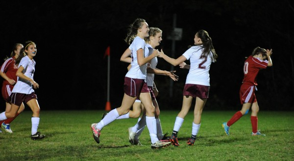 Members of the Bangor girls soccer team celebrate Emily Smith's goal during first-half action at Bangor on Friday.