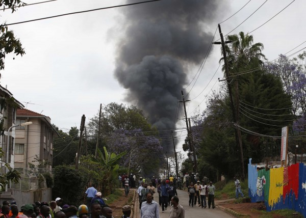 Smoke rises over Westgate Shopping Centre after an explosion in Nairobi, Sept. 23, 2013. Powerful explosions sent thick smoke billowing from the Nairobi mall where militants from Somalia's al Qaida-linked al Shabaab group threatened to kill hostages on the third day of a raid in which at least 59 have already died.