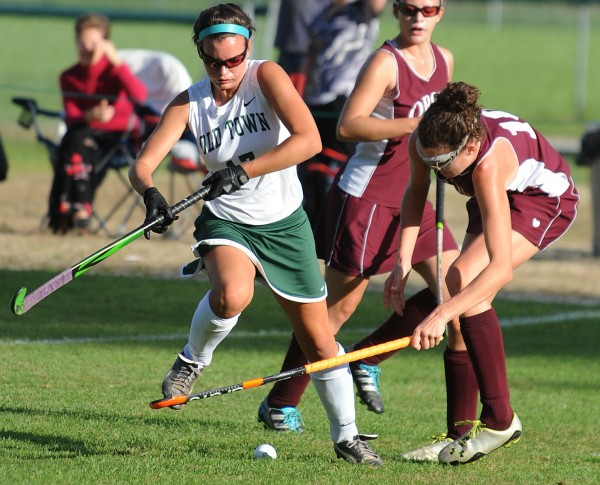 Old Town's Jody St. Jean (left) gets tripped up by Orono's Emma Honey  during first-half action on Monday at Old Town.