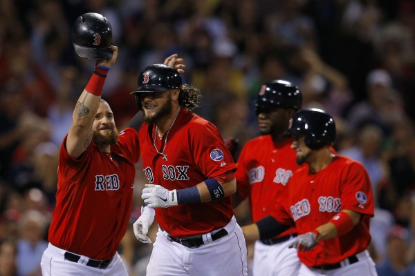Boston's Jarrod Saltalamacchia (second left) heads to the dugout after hitting a grand slam to score teammates Jonny Gomes (lef), David Ortiz (second right) and Shane Victorino (right) in the seventh inning against the New York Yankees at Fenway Park in Boston Friday night.