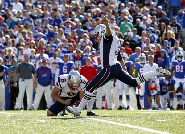New England Patriots kicker Stephen Gostkowski (3) kicks a field goal to win the game as punter Ryan Allen (6) holds during the fourth quarter against the Buffalo Bills at Ralph Wilson Stadium. Patriots beat the Bills 23-21.