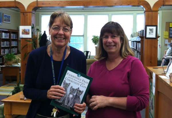 PMHSKC Representative Sue Howard presents a copy of Fairminded Fran and the Three Small Black Community Cats to Thomaston Public Library's Head Librarian Ann Harris