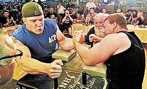 Arm wrestlers compete during a recent tournament organized by 207 Arm Sports.