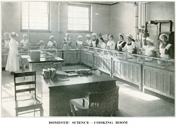 An image from the 1919-20 school catalog shows young women enrolled in Bangor High School's domestic science program.
