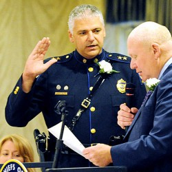 Auburn police Chief Phil Crowell is sworn in as the new president of the Maine Chiefs of Police Association by the organization's executive director, retired Chief Robert M. Schwartz, on Thursday evening at the Hilton Garden Inn Riverwatch in Auburn.