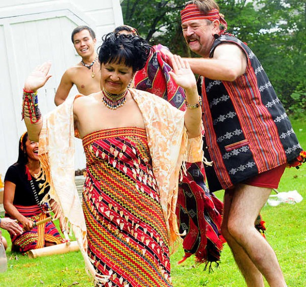 Joan and Harold Millette Jr. perform a traditional courtship dance from the Philippines, where Joan was born, during their wedding Saturday in Auburn. The couple had an American ceremony, followed by the Philippine celebration.
