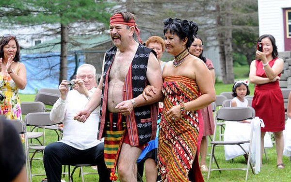 Harold Millette Jr. is &quotaccepted&quot into Joan (Gaerlan) Millette's tribe during the traditional Philippine ceremony at their wedding Saturday in Auburn.