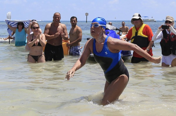 U.S. long-distance swimmer Diana Nyad, 64, walks to dry sand, completing her swim from Cuba as she arrives in Key West, Fla., Sept. 2, 2013. Nyad has become the first person to swim from Cuba without a shark cage.
