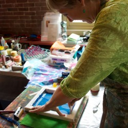 Textile artist Catherine Worthington demonstrates silkscreen painting at a Maine Fiberarts workshop in June. Photo credit: www.mainefiberarts.org