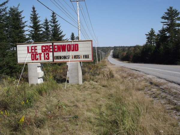 A sign along U.S. 1 in Columbia advertises the Worcester Wreath event featuring Lee Greenwood that will benefit Wreaths Across America.