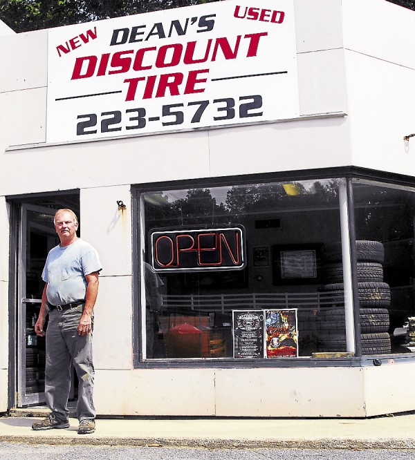 Dean Mooers stands outside his Dean's Discount Tire, located at 154 Main St., Winterport.. In 1998 Mooers relocated his business from Wilson Street in Brewer to in-town Winterport. Selling a 60-40 split of new and used tires, he's found a niche, and his business has thrived.