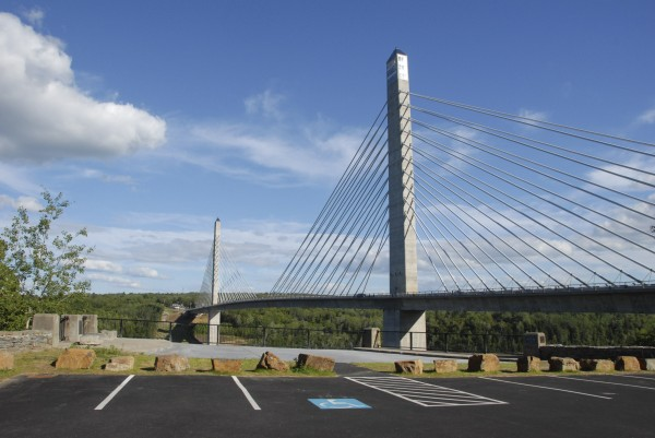 The Maine Department of Transportation has opened a historic overlook placed on the Prospect abutment of the former Waldo-Hancock Bridge. The overlook feature granite benches, nine parking spaces, two stone walls, and a viewing area from which visitors can enjoy excellent views of the adjacent Penobscot Narrows Bridge, the Penobscot River and Verona Island. Also located at the overlook are three historic plaques connected to the Waldo-Hancock Bridge, which was removed earlier this year.