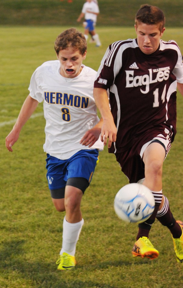 Hermon's Nathan Lynch and Ellsworth's Ben Haslam chase the ball down the field during first-half action at Hermon on Thursday.