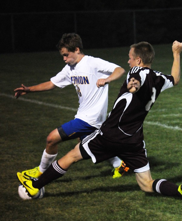 Hermon's Nathan Lynch and Ellsworth's Jack Weeks vie for control of the ball during first half action at Hermon on Thursday.