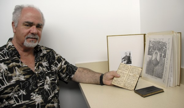 James Lawrence &quotLarry&quot Knight of Manchester, Conn. displays the two small diaries that his great-grandfather, Adelbert Knight of Belfast, kept while serving in the 11th Infantry, United States Army, during the Civil War. Behind the diaries is an album containing the diary entries that Larry Knight transcribed in 1970, when he was a high school senior. One diary includes many entries that Adelbert Knight made while imprisoned at Andersonville, Ga.