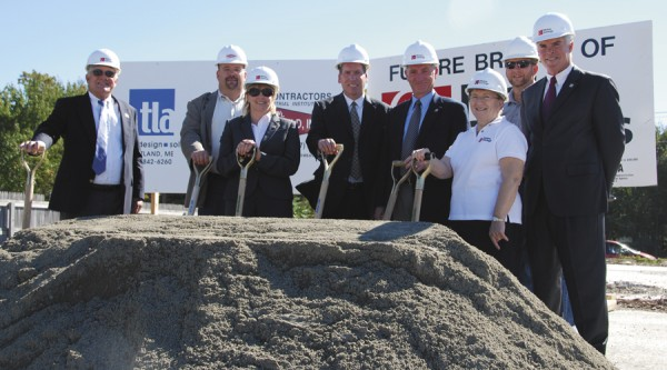 Participating in the Sept. 19 groundbreaking ceremony for a new Maine Savings Federal Credit Union branch at the corner of College and Stillwater avenues in Old Town were (from left) Joe Young, Maine Savings FCU supervisory committee member; Dwayne Littlefield of general contractor E.W. Littlefield Inc.; Kelly Karter, Maine Savings FCU board vice president; Jim Durgin, regional vice president for Theriault Landmann Associates Creative Design Solutions; John Reed, Maine Savings FCU president and CEO; Vivian Gresser, Maine Savings FCU director; Scott Braley, Plymouth Engineering; and Rob Carmichael, Maine Savings FCU senior vice president.