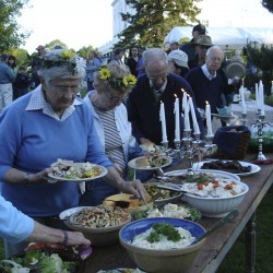 Guests help themselves at the public buffet table at Midsummer at the Museum held on the grounds of Montpelier in June.
