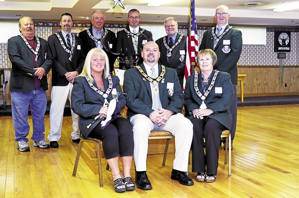 The current officers of the Old Town Elks Lodge 1287 are (front row, from left) Laurie Mitchell, Lodge Esquire; Corey Day, Exalted Ruler; Dianne Olsen, Chaplain; (back row) Steve Clark, Lodge Tiler; Mike Thibodeau, Esteemed Lecturing Knight; Bob Martin, Past Exalted Ruler and Secretary; Kyle Smart, Past Exalted Ruler and Esteemed Leading Knight; Carroll Spencer, Trustee; and Dan Smart, Trustee. Absent when the photo was taken are Paul Roy, Esteemed Loyal Knight; Scott Cates, Lodge Treasurer; Tim Mcgovern, Trustee; David St. Peter, Past Exalted Ruler and Secretary Trustee; and Gary Powers, Lodge Inner Guard.