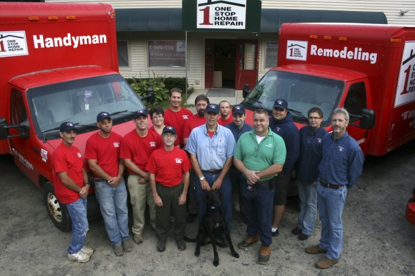 Representing Orono-based One Stop Home Repair are (front, sitting) Brody, mascot; (front, from left) Steve Doucette, painter; Howard Whelden, owner; and David Hjorth, GEB sales; and (rear, from left) Kevin Sands, carpenter; Philip Smith, plumber; Howard Whelden Jr., carpenter; Christine Henderson, office manager; Justin McAllister, handyman; Scott Nason, carpenter; Trey Feyler, handyman; Paul Bolduc, office support; Shawn Bouchard, electrician; Kim Chadbourne, office support; and Dan Farrell, estimator.
