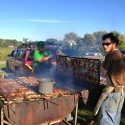 At KNOXFEST, the Museum's August event, Thomaston's Peter Lammert, l., grilled up his famous chicken with a little help..