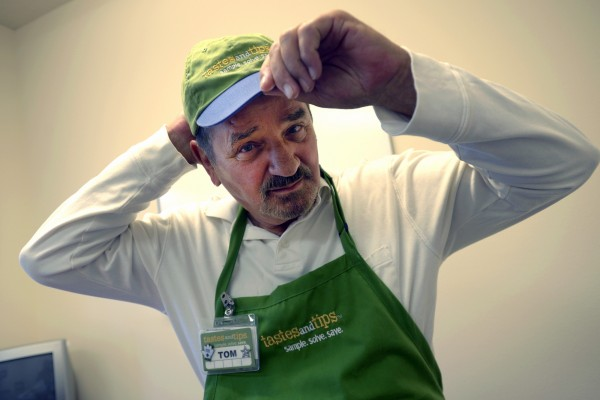 Tom Palome, 77, earns $10 an hour as a food demonstrator at Sam's Club.