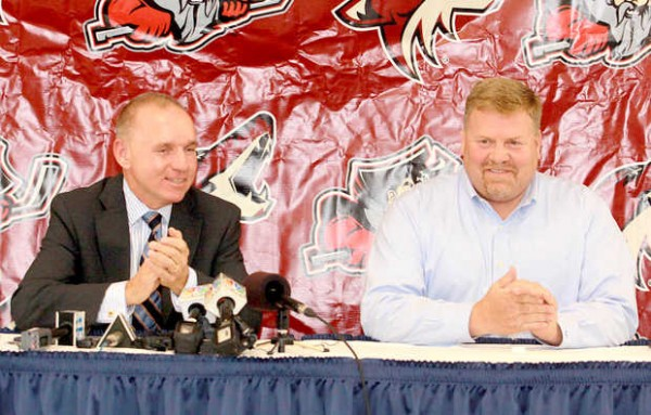 Portland Pirates CEO and Managin Owner Brian Petrovek, left, and part-owner of the Colisee, proprieter of Maine Hockey Group and investor in the Portland Pirates Ron Cain answer questions at a news conference in the Baxter Lounge at the Androscoggin Bank Colisee on Thursday.