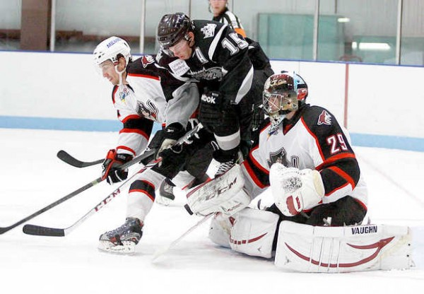 Pirates goaltender Mark Visentin makes a blocker save as Daine Todd of Portland battles Brandon Kozun of Manchester in third period action from Saco.