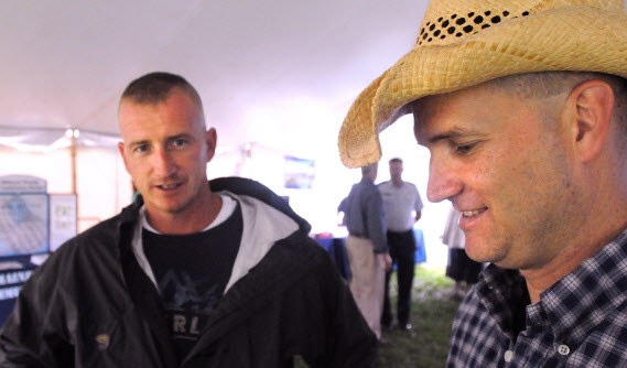 Command Sgt. Maj. Scott Doyon (right) and Master Sgt. John Brooks serve full time in the Maine Army National Guard. They have been deployed three times together and between the two of them have nine total deployments. They came to the waterfront to see the Toby Keith concert and they also stopped at a tent that offered information to military members about available help and benefits.